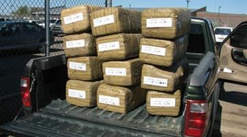 Law enforcement officials say they've broken up a ring that smuggled thousands of pounds of marijuana a year for three years from Mexico into Pinal County. By Jennifer Thomas