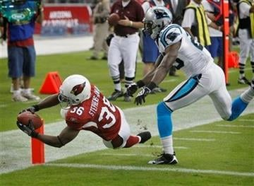 Arizona Cardinals running back LaRod Stephens-Howling (36) scores a touchdown as Carolina Panthers cornerback Sherrod Martin defends during the first half of an NFL football game Sunday, Nov. 1, 2009, in Glendale, Ariz. (AP Photo/Matt York) By Matt York