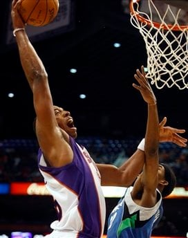 Phoenix Suns Channing Frye, left, dunks over Minnesota Timberwolves Corey Brewer during the third quarter of an NBA basketball game on Sunday, Nov. 1, 2009, in Phoenix. (AP Photo/Rick Scuteri) By Rick Scuteri