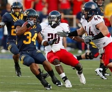 California's Shane Vereen, left, looks for a way around Arizona defensive end Ricky Elmore (44) during the first half of an NCAA college football game Saturday, Nov. 14, 2009, in Berkeley, Calif. (AP Photo/Ben Margot) By Ben Margot
