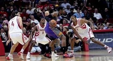 Phoenix Suns' Amare Stoudemire is triple teamed by Houston Rockets' Luis Scola, Aaron Brooks, and Trevor Ariza in the fourth quarter during a NBA basketball game on Tuesday Nov. 17, 2009 in Houston. Phoenix won 111-105.(AP Photo/Bob Levey) By Bob Levey