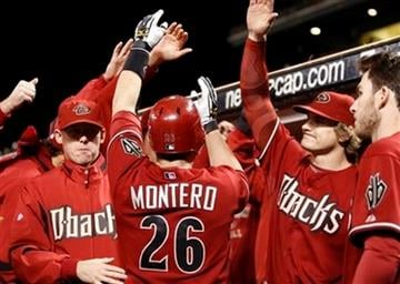 Arizona Diamondbacks' Miguel Montero (26) is congratulated after hitting a home run off San Francisco Giants' Jonathan Sanchez in the fourth inning of a baseball game Tuesday, Sept. 29, 2009, in San Francisco. (AP Photo/Ben Margot) By Ben Margot