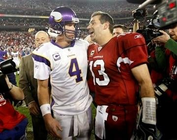 Arizona Cardinals quarterback Kurt Warner (13) and Minnesota Vikings quarterback Brett Favre (4) meet at midfield after an NFL football game Sunday, Dec. 6, 2009 in Glendale, Ariz. The Cardinals won 30-17. (AP Photo/Matt York) By Matt York