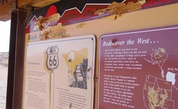 Vandals recently shot the Route 66 interpretive signs about three miles north of Golden Shores, Ariz. By Jennifer Thomas