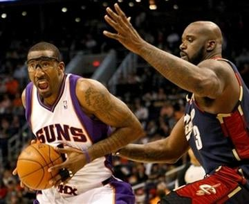 Phoenix Suns' Amare Stoudemire (1) drives past Cleveland Cavaliers' Shaquille O'Neal during the third quarter of an NBA basketball game Monday, Dec. 21, 2009, in Phoenix. (AP Photo/Matt York) By Matt York