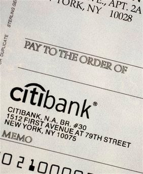 In this Dec. 27, 2009 photo, a detail of a blank check is shown in New York. Most payments can now be made electronically, so why use checks? (AP Photo/Mark Lennihan) By Mark Lennihan