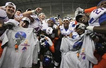 Boise State players celebrate their victory over TCU after the Fiesta Bowl NCAA college football game Monday, Jan. 4, 2010, in Glendale, Ariz.  Boise State defeated TCU 17-10. (AP Photo/Ross D. Franklin) By Ross Franklin