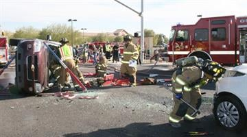 A couple in their 70s were trapped inside their minivan after colliding with a car outside a grocery store in Maricopa. By Jennifer Thomas