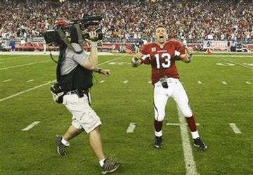 Arizona Cardinals quarterback Kurt Warner celebrates after overtime of an NFL wild-card playoff football game against the Green Bay Packers Sunday, Jan. 10, 2010, in Glendale, Ariz. Arizona won 51-45. By Catherine Holland