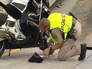 A motorcycle officer with the Buckeye Police Department was injured in a one-vehicle collision at Loop 202 and Scottsdale Road. By Jennifer Thomas