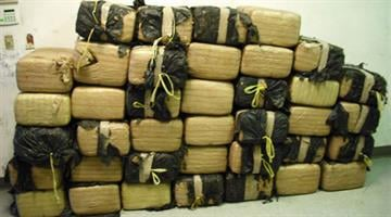 U.S. Border Patrol agents found 948 pounds of marijuana inside a truck concealed in brush near Nogales, Ariz. By Jennifer Thomas