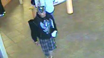 Surveillance photo of armed bank robbery suspect. By Alicia Barron