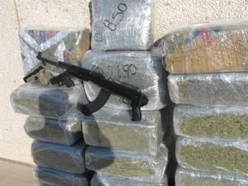"West Phoenix ""stash house"" contained weapons and 400 pounds of marijuana By Jennifer Thomas"