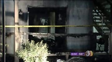 Nearly two dozen people don't have places to live after an early morning fire ripped through a pair of condos Tuesday, trapping two people in an upstairs unit. By Catherine Holland