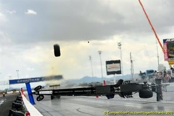 A woman sitting in the stands at Firebird International Raceway was struck and killed by a flying tire after wreck during Sunday's NHRA races. By Catherine Holland