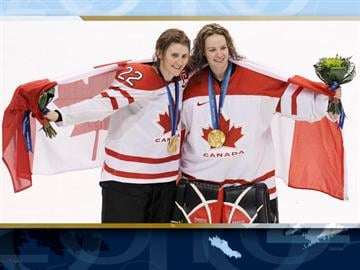 Canada forward Hayley Wickenheiser and goalie Shannon Szabados (l-r) celebrate after Canada beat the US to win gold medal in Women's ice hockey at the Vancouver 2010 Olympics in Vancouver, British Columbia. By AP