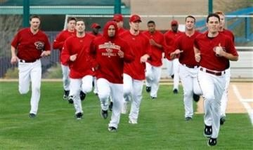 Arizona Diamondbacks' pitchers and catchers run to get in shape during the first day of baseball spring training camp in Tucson, Ariz., on Saturday, Feb. 20, 2010. (AP Photo/Ed Andrieski) By Ed Andrieski
