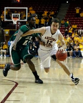 Arizona State's Derek Glasser, right, drives on Jacksonville's Chris Edwards during the second half of a first-round NIT college NCAA basketball game on Tuesday, March 16, 2010 in Tempe, Ariz. (AP Photo/Rick Scuteri) By Rick Scuteri