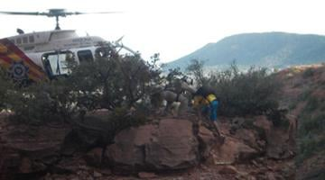 A DPS Ranger helicopter picked up a stranded hiker off a rock spire near Sedona By Jennifer Thomas