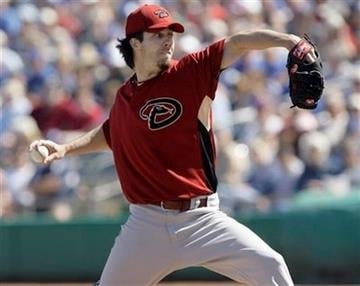 Arizona Diamondbacks pitcher Dan Haren works against the Chicago Cubs in the first inning of an MLB spring training baseball game Friday, March 5, 2010, in Mesa, Ariz. (AP Photo/Paul Connors) By Paul Connors