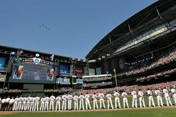 The Arizona Diamondbacks and San Diego Padres line up during the national anthem before the baseball teams' season opener Monday, April 5, 2010, in Phoenix. (AP Photo/Matt York) By Matt York