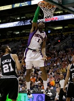 Phoenix Suns' Amare Stoudemire (1) dunks over San Antonio Spurs' Tim Duncan (21) during the third quarter of an NBA basketball game Wednesday, April 7, 2010 in Phoenix. (AP Photo/Matt York) By Matt York
