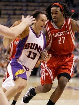 Phoenix Suns guard Steve Nash, left, drives to the basket around Houston Rockets forward Jordan Hill, right, in the third quarter of an NBA basketball game Sunday, April 11, 2010, in Phoenix. The Suns won 116-106. (AP Photo/Paul Connors) By Paul Connors