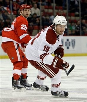 Phoenix Coyotes' Shane Doan (19) keeps his eye on the puck as Detroit Red Wings defenseman Brian Rafalski (28) defends during the first period of an NHL hockey game in Detroit, on Tuesday, Jan. 26, 2010.  (AP Photo/Paul Sancya) By Paul Sancya