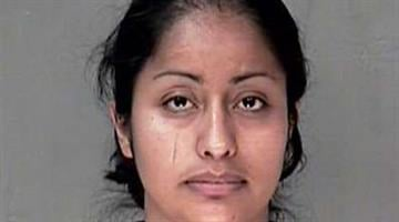 Maria Salas-Carrera was arrested and faces animal cruelty charges. By Alicia Barron