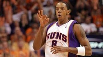 Phoenix Suns center Channing Frye holds up three fingers in celebration after making a three-point field goal against the Portland Trail Blazers during the second half of Game 5. By Catherine Holland