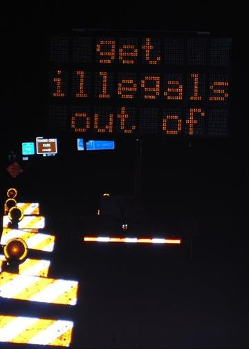 """Early Wednesday morning along west Ina road, an electronic sign flashed the message """"sb1070 rules get illegals out of ARIZONA!"""" By Fox 11"""