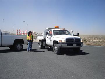 ADOT crews fight the wind to close I-40 near Winslow on May 11. By Jennifer Thomas