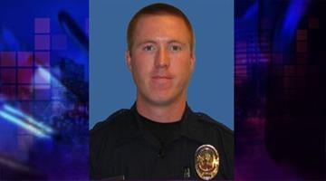 Phoenix Officer Travis Murphy killed in the line of duty on May 26, 2010. By Natalie Rivers