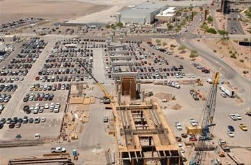 The PHX Sky Train guideway path is now much easier to see. This is an aerial view of the construction of East Economy lot train station. You can clearly see the pillars which will support the guideway winding west toward Terminal 4. By Natalie Rivers