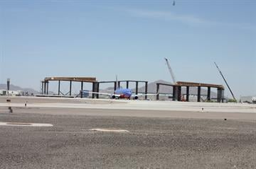When the bridge over Taxiway R is complete, it will be high enough to allow a 747 to pass underneath. By Natalie Rivers