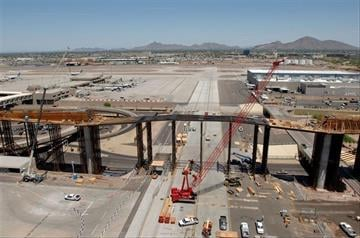 Construction of the PHX Sky Train bridge over Taxiway R on the east side of Sky Harbor is well underway. This is an aerial photo of the bridge construction. By Natalie Rivers