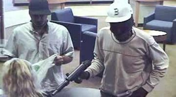 Two men are in custody after allegedly using a fake submachine gun to hold up a Chase bank branch in Phoenix last week. By Catherine Holland
