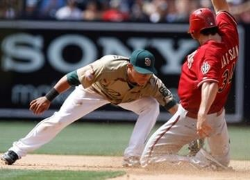 Arizona Diamondbacks' Conor Jackson, right,  is caught stealing on a tag by San Diego Padres shortstop Everth Cabrera, during the fifth inning of a baseball game Sunday, April 18, 2010 in San Diego. (AP Photo/Denis Poroy) By Denis Poroy