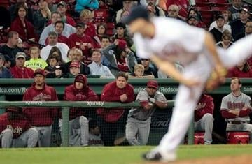 Arizona Diamondbacks watch from the bench as Boston Red Sox closer Jonathan Papelbon pitches in the ninth inning of a baseball game, Thursday, June 17, 2010, in Boston. The Red Sox won 8-5. (AP Photo/Michael Dwyer) By Michael Dwyer