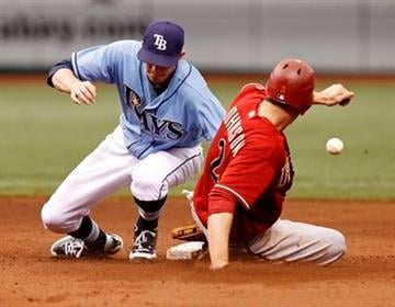 Arizona Diamondbacks' Kelly Johnson, right, steals second base the ball gets away from Tampa Bay Rays shortstop Reid Brignac during the fifth inning of a baseball game Sunday, June 27, 2010, in St. Petersburg, Fla.  (AP Photo/Mike Carlson) By MIKE CARLSON