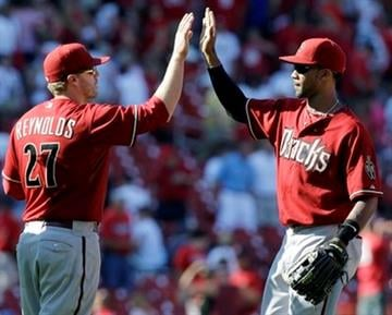 Arizona Diamondbacks' Mark Reynolds, left, and teammate Chris Young celebrate the Diamondbacks' 4-2 victory over the St. Louis Cardinals in a baseball game Wednesday, June 30, 2010, in St. Louis. (AP Photo/Jeff Roberson) By Jeff Roberson