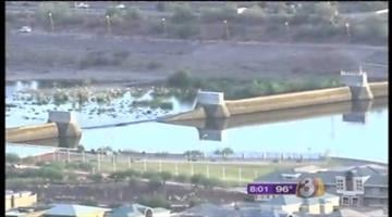 Tempe Town Lake is down to a depth of about 3 feet after one of the rubber bladders that make up the dam burst, allowing millions of gallons of water to rush into the dry river bed. By Catherine Holland