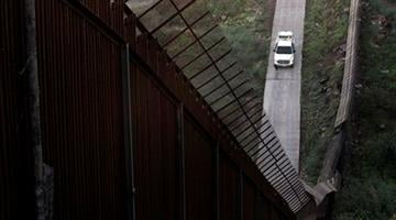 A Border Patrol vehicle sits along the border fence separating Nogales, Ariz., and Nogales, Sonora, Mexico,  Wednesday, July 28, 2010. Arizona's new immigration law SB1070 takes effect Thursday, July 29. (AP Photo/Jae C. Hong) By Jae C. Hong