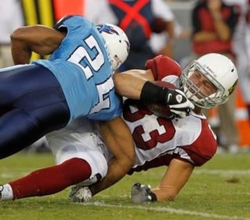 Arizona Cardinals tight end Stephen Spach (83) is brought down by Tennessee Titans safety Chris Hope (24) in the first quarter of a preseason NFL football game on Monday, Aug. 23, 2010, in Nashville, Tenn. (AP Photo/Wade Payne) By Wade Payne