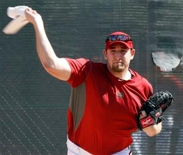 Arizona Diamondbacks pitcher Brandon Webb uses a towel to work on his delivery during  spring training baseball in Tucson, Ariz., on Wednesday, Feb. 24, 2010. (AP Photo/Ed Andrieski) By Ed Andrieski
