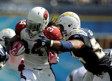 Arizona Cardinals running back Tim Hightower runs around San Diego Chargers linebacker Stephen Cooper during first half of an NFL football game Sunday, Oct. 3, 2010, in San Diego. (AP Photo/Chris Carlson) By Chris Carlson