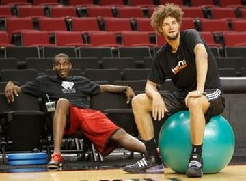 Phoenix Suns' Amare Stoudemire, left, and teammate Robin Lopez look on during practice for their NBA first-round playoff basketball series on Friday, April 23, 2010, in Portland, Ore.  (AP Photo/Rick Bowmer) By Rick Bowmer