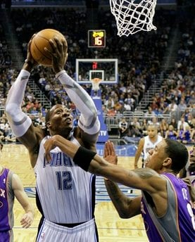 Orlando Magic center Dwight Howard (12) goes up for a shot over Phoenix Suns center Channing Frye during the first half of an NBA basketball game in Orlando, Fla., Thursday, Nov. 18, 2010. (AP Photo/John Raoux) By John Raoux