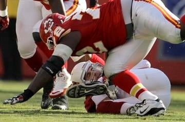 Arizona Cardinals quarterback Derek Anderson, back, is sacked by Kansas City Chiefs defensive end Glenn Dorsey (72) during the second quarter an NFL football game Sunday, Nov. 21, 2010 in Kansas City, Mo. (AP Photo/Charlie Riedel) By Charlie Riedel