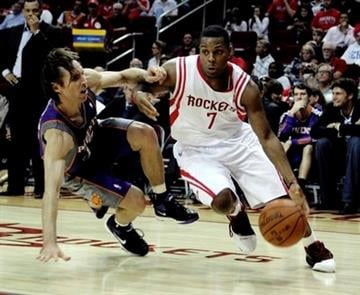 Houston Rockets' Kyle Lowry drives past Phoenix Suns' Steve Nash as he loses his balance in the third quarter during a NBA basketball game on Monday, Nov. 22, 2010, in Houston. Phoenix Suns won 123-116.(AP Photo/Bob Levey) By Bob Levey